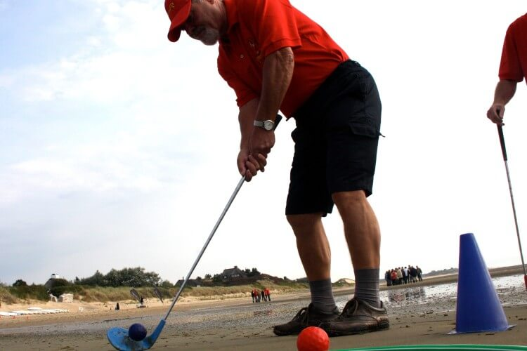 Golfspieler am Strand